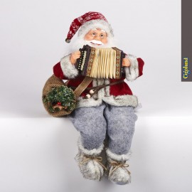 Père Noël assis joue accordéon